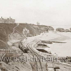 1899, at this stage sand and gravel were being taken off the Terrace Beach only (for manufacture of concrete blocks for new piers etc). Later the beach railway would be extended past the Featherbed Rock onto the North Beach.