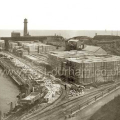 Building of the North Pier. Photograph 30th July 1901Blockyard at centre, 20 and 30 ton blocks were manufactured here for building piers.