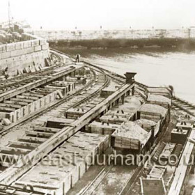 Small Blockyard, wooden moulds for making concrete blocks. Oct 1899 looking east from old lighthouse. Old north pier at top.