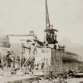 Building North Pier in 1901.20 and 30 ton blocks used.