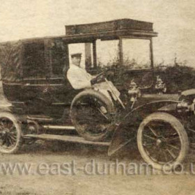 One of Thomas Lamb's first motor vehicles after moving to Seaham's Livery Stables on the Castlereagh Bridge. The car, a Mercedes or Napier was bought before 1914 and is driven here by his nephew  John of Dalton le Dale. John died in France in 1918.